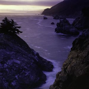 Looking north from Julia Pfeiffer State Park at sunset.  The rocky coast linecreates small beaches safe for sea creatures.