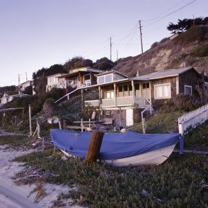 Walter Shatford III, known as Wolfgang, handmade this boat by casting resin against a wooden form in one of the leaning garages at Crystal Cove, Laguna Beach.  The Shatfords lived in the house beyond the boat.