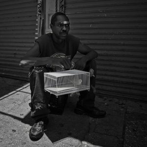 A resident of Los Angeles Skid Row gives his bird some fresh air.